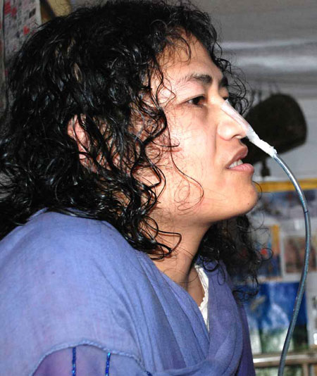 A picture of activist Irom Sharmila, with an oxygen pipe stuck to her nose.