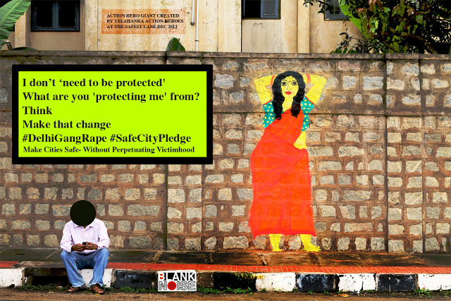 "photo shows a brown wall which has an illustration of a woman dressed in a red saree and blur blouse. a man sits in fron of the wall, but his face is blacked out. The message written on the wall says, ""i don't 'need to be protected'/ What are you 'protecting me' from? / Think / Make That Change #DelhiGangRape #SafeCityPledge"