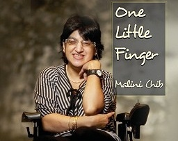 A picture of disability rights activist Malini Chib sitting on a wheelchair. She is has black shoulder-length hair and is wearing glasses. Her top is white with black stripes and her trousers are black. The text beside her reads 'One Little Finger, Malini Chib'