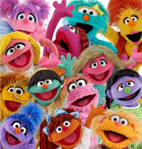 A picture of multicoloured puppets from the show 'sesame street'