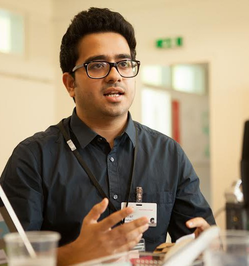 Picture of Anshul Tewari, the founder of Youth Ki Awaaz. He's wearing a black shirt and dark rimmed glasses