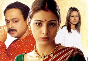 """Poster of film """"Astitiva"""". A woman wearing red bindi and mangalsutra is standing in the middle. A man on her left behind her with his side face, caressing his moustache. Another woman to her right behind the man, wearing white top, and long open hair."""