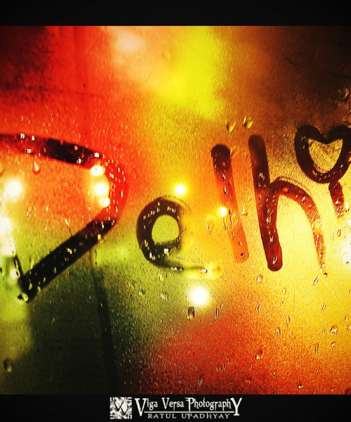 A fogged glass window with the word 'Delhi' outlined in it
