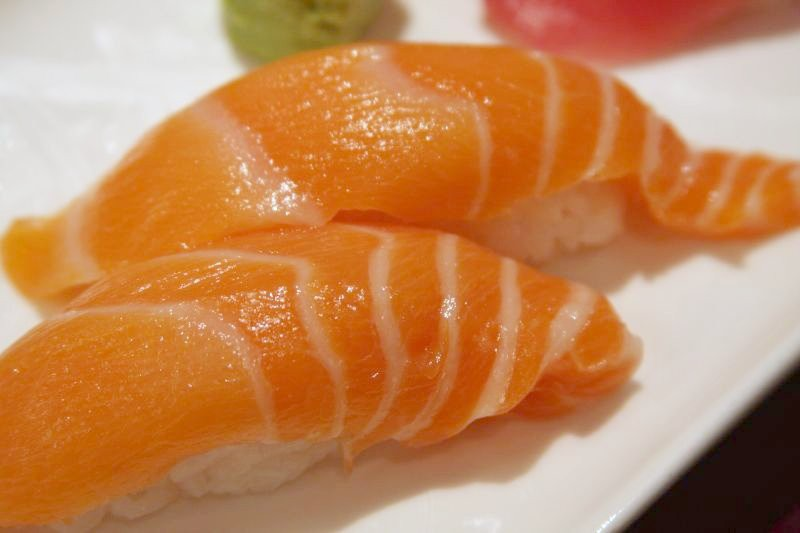 Sushi on a white plate.