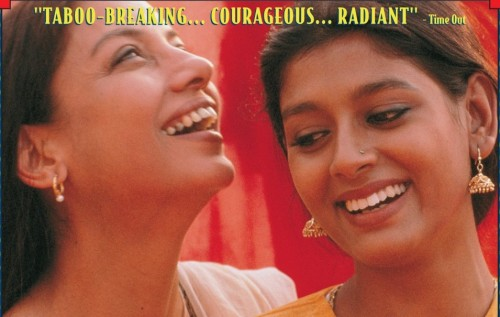 """Poster of the film """"Fire"""". Two young Indian women wearing kajal and earrings laughing. Screen reader support enabled. Poster of the film """"Fire"""". Two young Indian women wearing kajal and earrings laughing."""