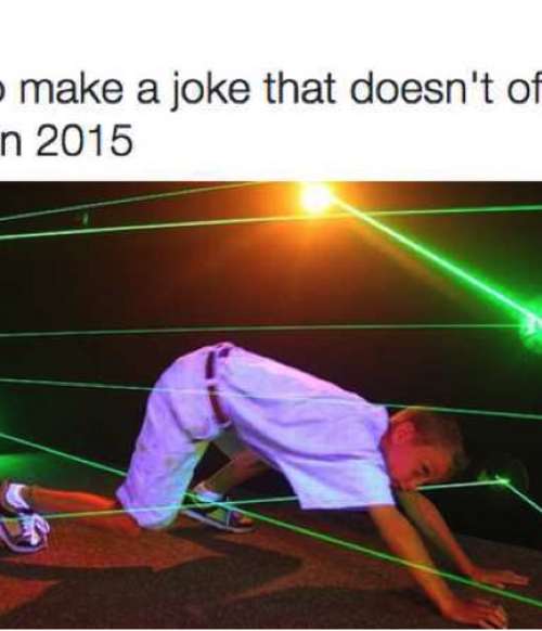 """A school boy trying to move through several intersecting and haphazard green light rays without touching any. On top of the photo is written, """"Trying to make a joke that doesn't offend anyone in 2015."""""""