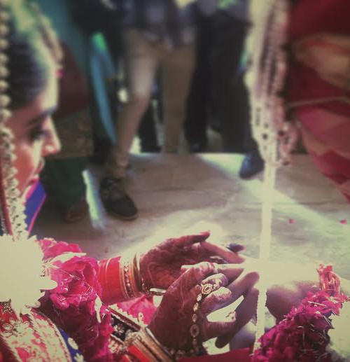 In Plainspeak English Audit In Plainspeak English Audit 100% 10 A Hindu bride placing a ring on the groom's finger. Screen reader support enabled. A Hindu bride placing a ring on the groom's finger.