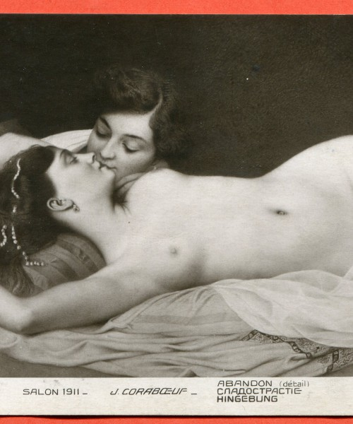 Two women kissing each other.