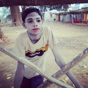 A young Odissi dancer hangs around after the Ramleela performance wrapped up for the day, at Village Debgarh.