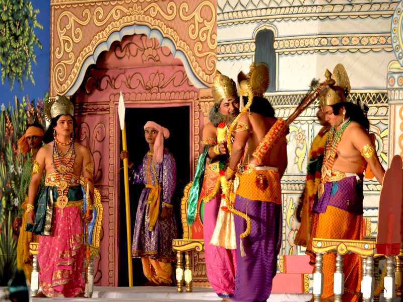 The staging of a Ramleela performance, with actors dressed in costumes representing mythological figures