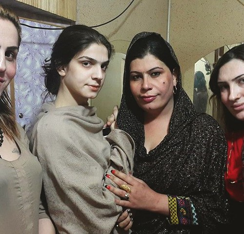 Photo of four transgender people.