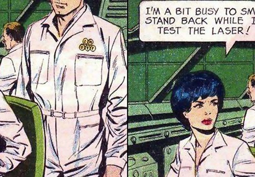"A two-panel comic. A man in white pants and tucked-in white shirt stands behind a woman who is wearing similar clothing. She looks to the side while working on some machine at the table. She says with a stern face to him, ""I am a bit busy to smile. Stand back while I test the laser."""