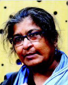 Dr Chayanika Shah wearing glasses, blue earrings, and a blu chunni round her neck.