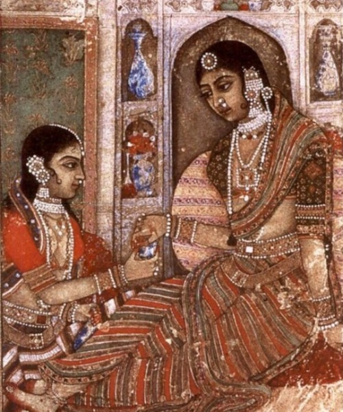 Artwork showing two women sitting, both wearing saree and heavy jewellery. Screen reader support enabled. Artwork showing two women sitting, both wearing saree and heavy jewellery.