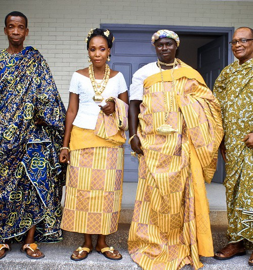 Portrait of a group of people dressed in traditional attire from a part of Africa.