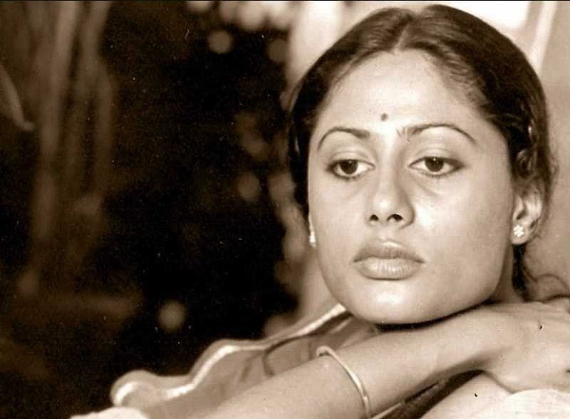 An Indian woman in a saree in a sepia photo, thinking something. We can see her from shoulders up. Screen reader support enabled. An Indian woman in a saree in a sepia photo, thinking something. We can see her from shoulders up.