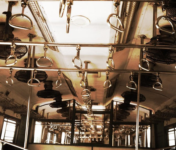 A shot of a ceiling of a bus, showing grab handles and fans attached to the ceiling. Screen reader support enabled. A shot of a ceiling of a bus, showing grab handles and fans attached to the ceiling.