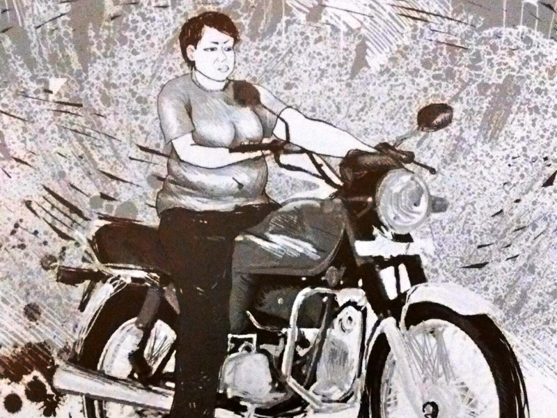 Illustration of a woman with boy-cut hair sitting on a motorcycle. She is wearing tee shirt and jeans.