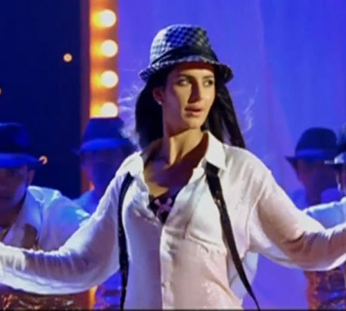 Still showing actress Katrina Kaif wearing a white shart and black hat