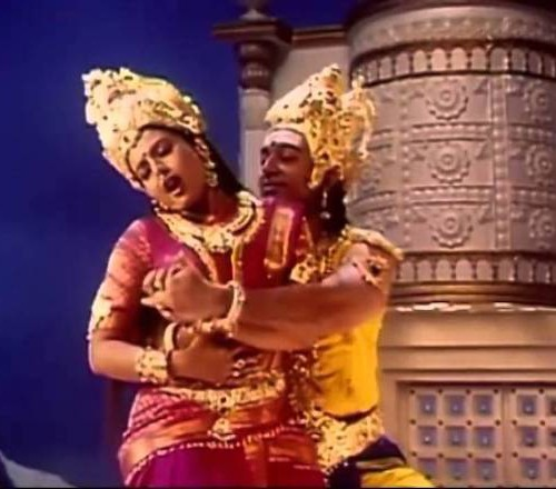 A photograph of Kaathala Kaathala , where the man wearing a heavily dressed head gearis trying to grope a woman from behond, while the woman is trying to get rid of his hold. She is also dressed in saree and a heavy head gear. Screen reader support enabled. A photograph of Kaathala Kaathala , where the man wearing a heavily dressed head gearis trying to grope a woman from behond, while the woman is trying to get rid of his hold. She is also dressed in saree and a heavy head gear.