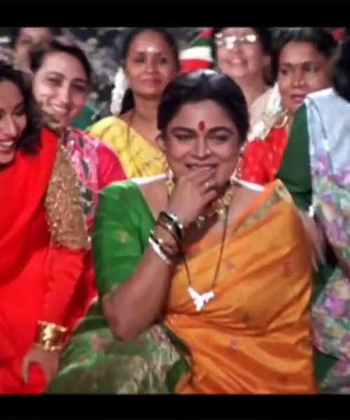 Its a still from the movie, Hum Aapke Hain Koun, featuring Madhuri Dixit, Reema Lagoo & Sahila Chadda