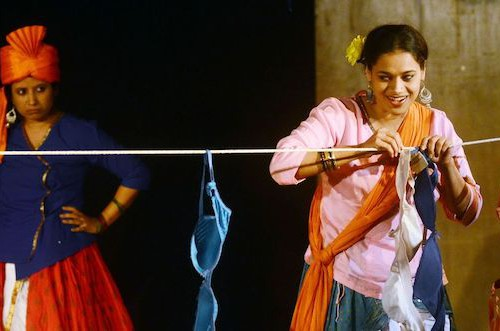 Theres are two photos which are stills from the play,Dohri Zindagi. In thr first photograph, there are two women,one is impersonating a man and the other woman is drying out her laundry (bras), she has a sunflower in her hair. In the second photograph the same women are holding eachother and facing eachother. The third photograph is a still of Vijaydan Detha from his documentary.