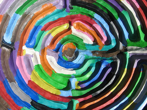 Its a a painting of a maze madeof acrylic using pride colors.