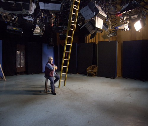 Shohini Ghosh at a film set. Lights, cameras, and reltaed instruments are hanging from the ceiling.