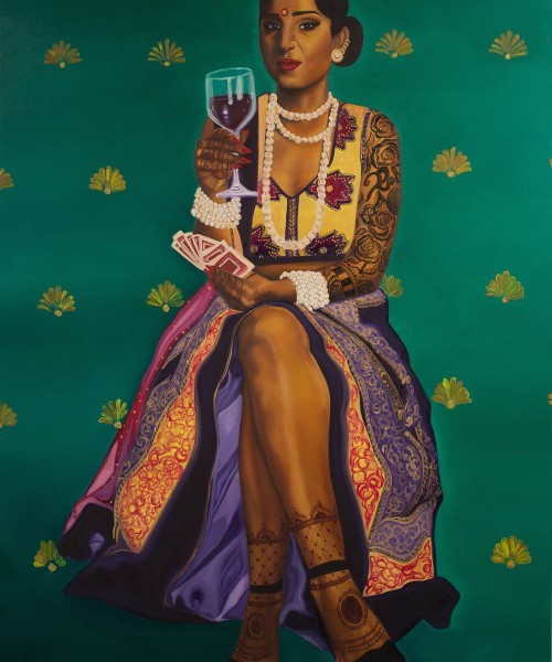 """Nimisha Bhanot's painting titled """"Money, Kitty Parties & Clothes Is All A Bahu Knows"""". A brown woman sits on a stool with her legs crossed, red wine in right hand, and cards in the left. She wears a cut-sleeves lehnga; heavy white jewellery in the neck and wrists; and mehndi in hands, full arms, and feet. The lehnga is pulled-up till the knee, showing her legs. She weas a bindi, a nose ring, and a red lisptick, and is staring straight-ahead expression-less."""