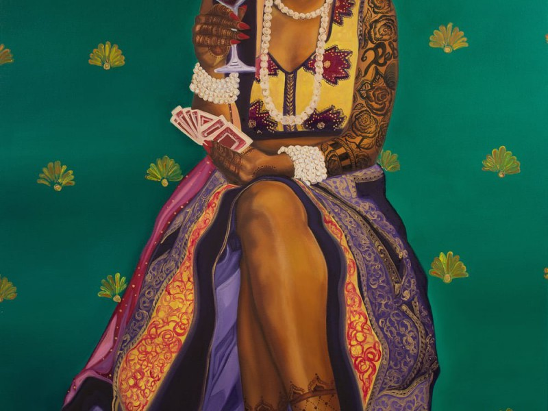 "Nimisha Bhanot's painting titled ""Money, Kitty Parties & Clothes Is All A Bahu Knows"". A brown woman sits on a stool with her legs crossed, red wine in right hand, and cards in the left. She wears a cut-sleeves lehnga; heavy white jewellery in the neck and wrists; and mehndi in hands, full arms, and feet. The lehnga is pulled-up till the knee, showing her legs. She weas a bindi, a nose ring, and a red lisptick, and is staring straight-ahead expression-less."