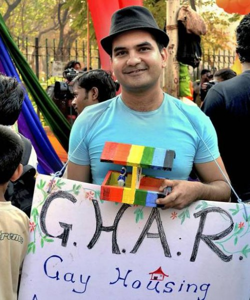 Photo of founder Sachin Jain, holding up a placard that says 'G.H.A.R'