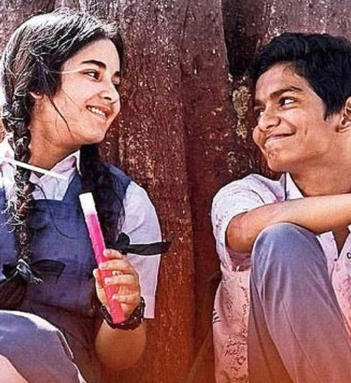 A still from the film 'Secret Superstar', showing a young girl and boy staring at each othjer, both wearing school uniforms