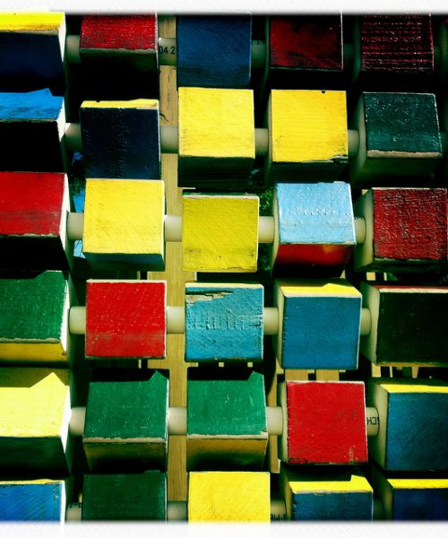 A photo of blocks of different colours stacked together