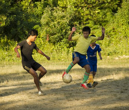 boys playing football in Manipur