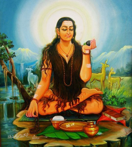 picture of a female saint meditating in what looks like a forest like area. her eyes are closed and there are lines of paint on her forehead signifying religious faith