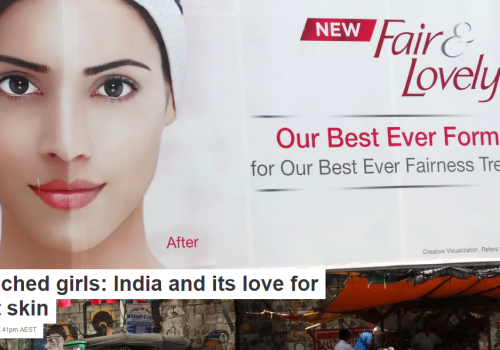 Picture of a woman on a billboard, half of her face is fair-complexion, the other half is dark-complexioned
