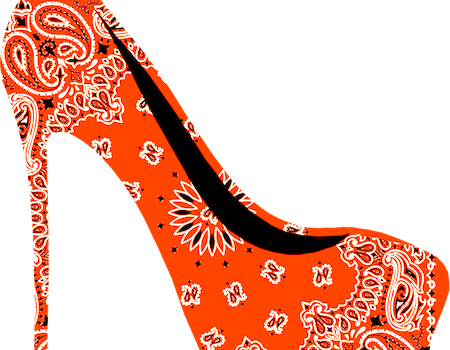 picture of a high-heel shoe, it is orange in colour with patterns on it