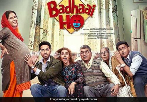 poster for the bollywood film, 'badhai ho', where four people are trying to listen to s pregnant woman's belly