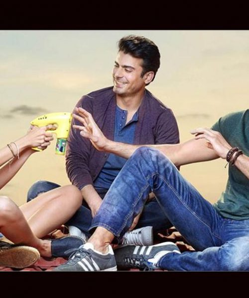 a still from 'Kapoor and Sons', two men and a woman sit together, laughing