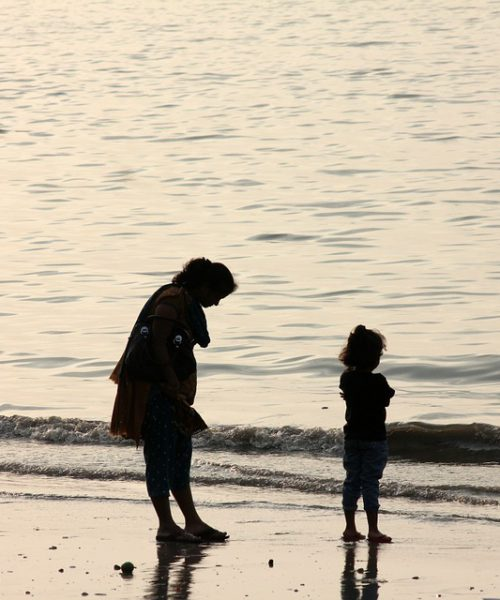 silhouette of a mother with her child