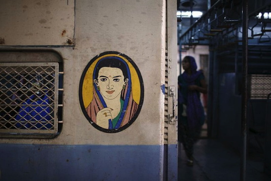 Bombay local: Icon outside women's compartments on Mumbai suburban trains.
