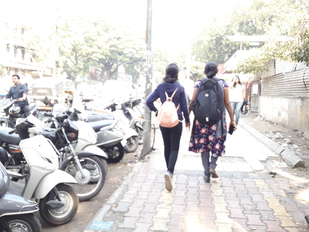 two women walking down a street