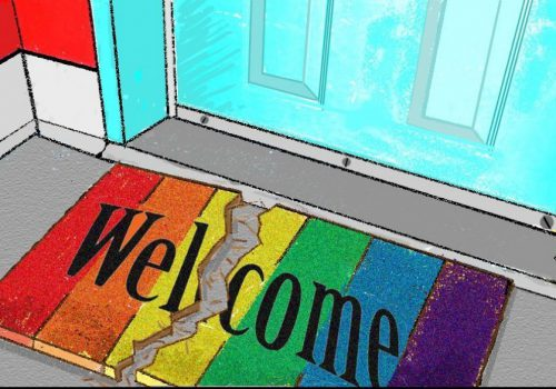 A welcome mat with the rainbow flag on it, it is torn in the middle