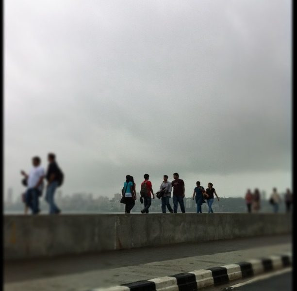 A group of people standing in a line at Mumbai's Marine Drive