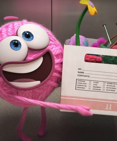 A still from Pixar's 'Purl', showing a smiling pink ball of yarn