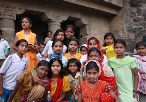 picture of a group of young girls posing together, in rural India