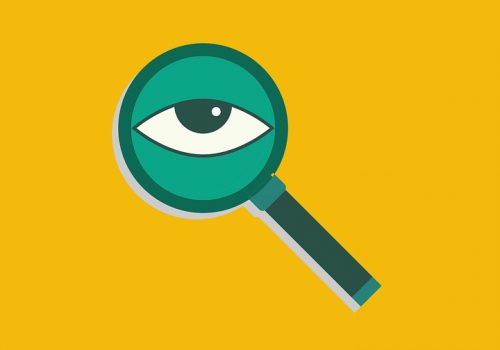 female private investigators in india: picture of an eye looking through a magnifying glass