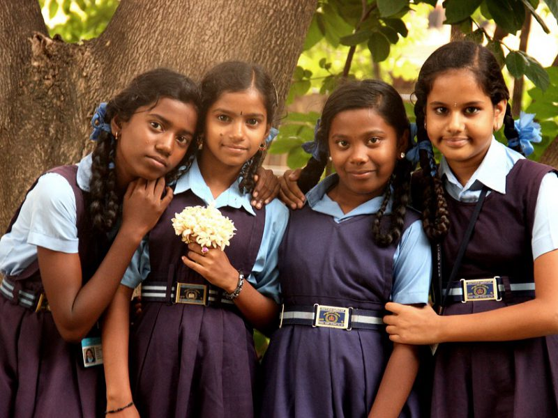 A picture of a group of young girls in school uniform