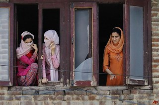 Kashmiri women watching a protest