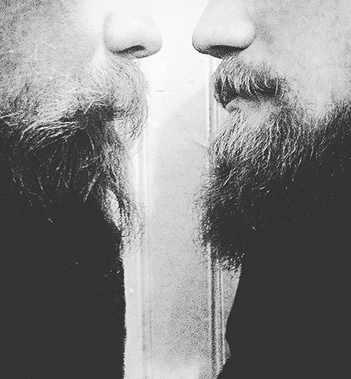 Two men with beards face each other